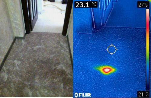 Локализация дефекта электрического кабеля в стяжке пола с помощью высоковольтного разрядника и тепловизионной камеры.